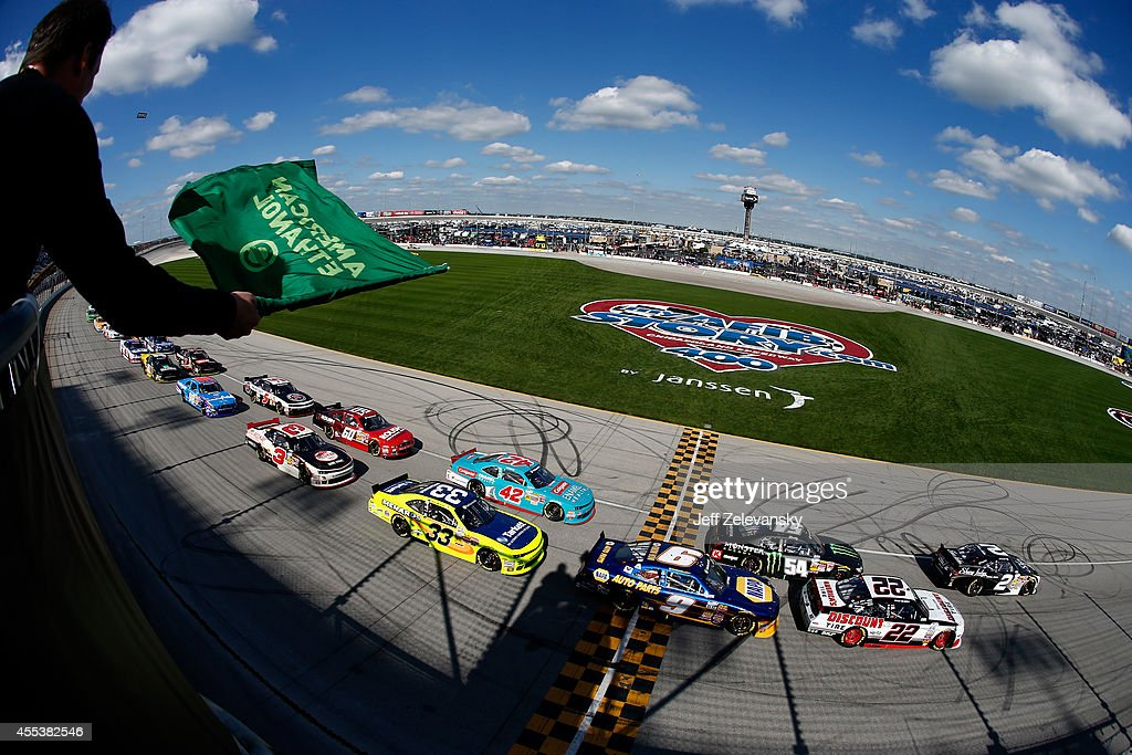 Brian Scott driver of the Shore Lodge Chevrolet leads thre field past the green flag to start during the NASCAR Nationwide Series Jimmy John's Freaky...