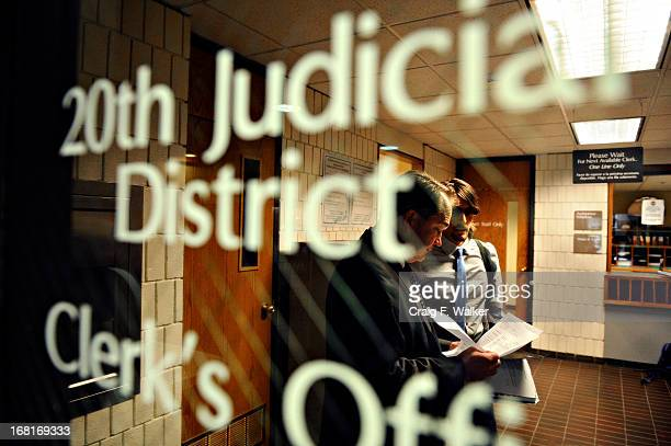 Brian Scott Ostrom talks with his attorney Christopher Griffin after a court appearance at the Boulder County Justice Center on June 16 2011 Scott...