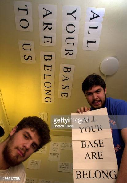 Brian Seeve from Amherst Mass left and Michael Tucker from Milton Mass have covered their dorm room walls and ceiling with the words 'All your Base...