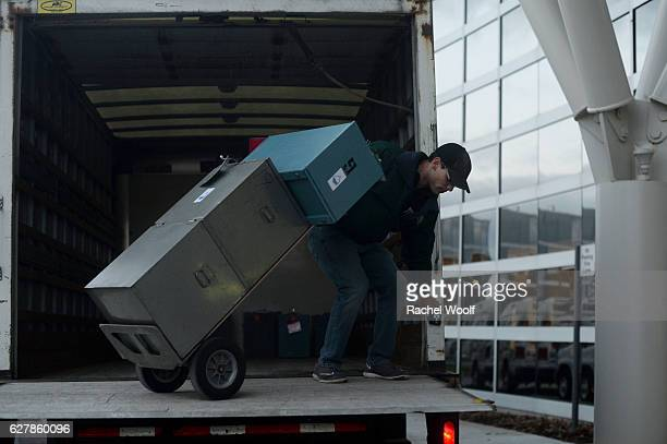 Brian Semple an Oakland County general maintenance mechanic transports uncounted ballots for volunteers and city officials to recount after a federal...