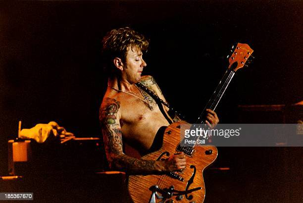 Brian Setzer of The Stray Cats performs on stage at the Town Country Club on October 6th 1992 in London England