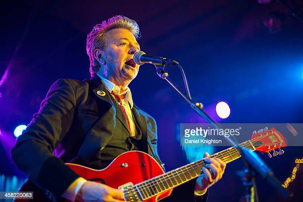 Brian Setzer performs with The Brian Setzer Orchestra during their Christmas Rocks 10th Anniversary Tour at Belly Up Tavern on December 20 2013 in...