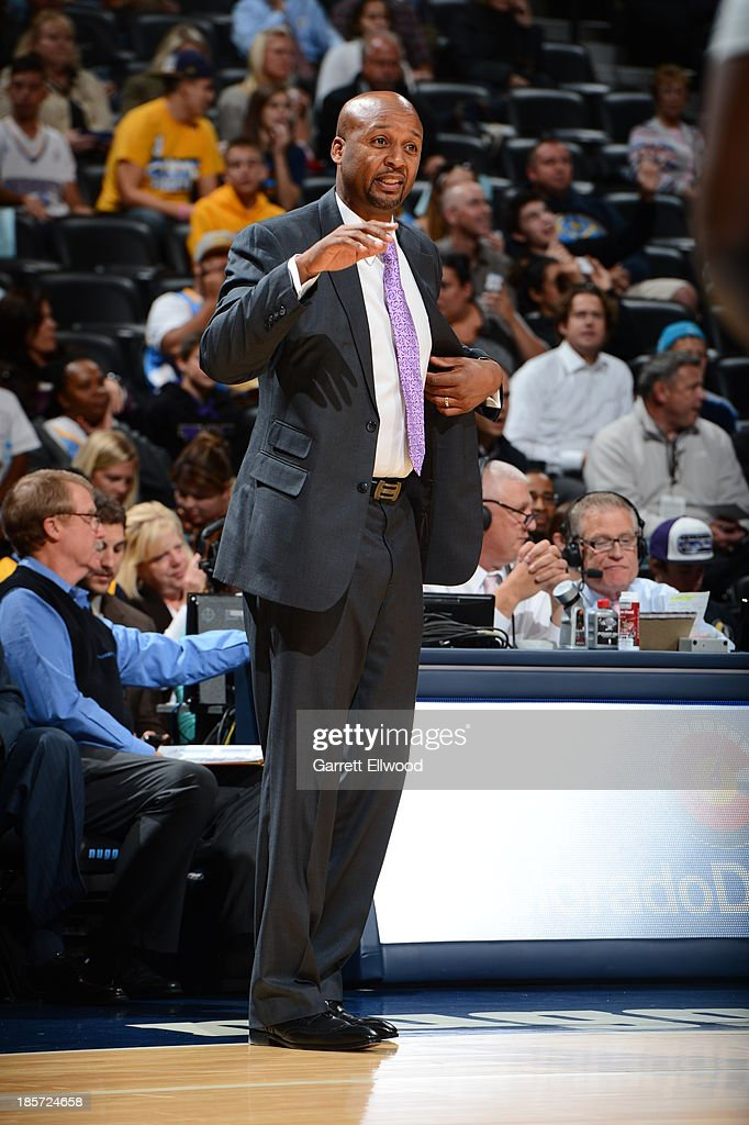 Brian Shaw of the Denver Nuggets coaches against the San Antonio Spurs on October 14, 2013 at the Pepsi Center in Denver, Colorado.