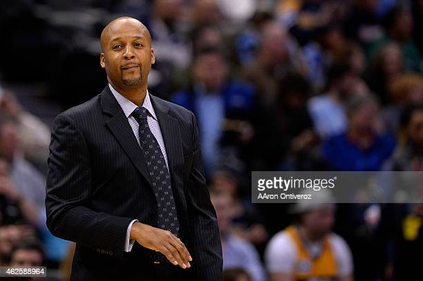 Brian Shaw of the Denver Nuggets watches his team play against the Charlotte Hornets during the first quarter of action The Denver Nuggets hosted the...