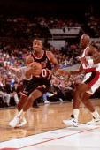 Brian Shaw of the Miami Heat dribbles against Terry Porter of the Portland Trailblazers during a game played circa 1991 at Memorial Coliseum in...