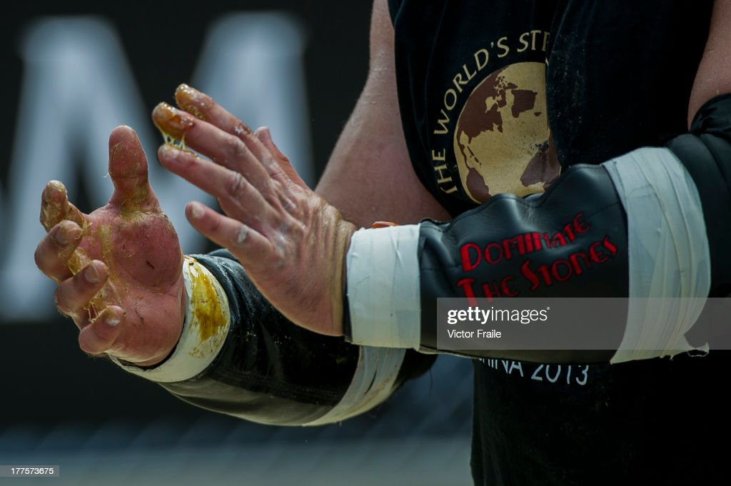 Brian Shaw of USA (detail) competes at the Atlas Stones event during the World's Strongest Man competition at Yalong Bay Cultural Square on August 24, 2013 in Hainan Island, China.
