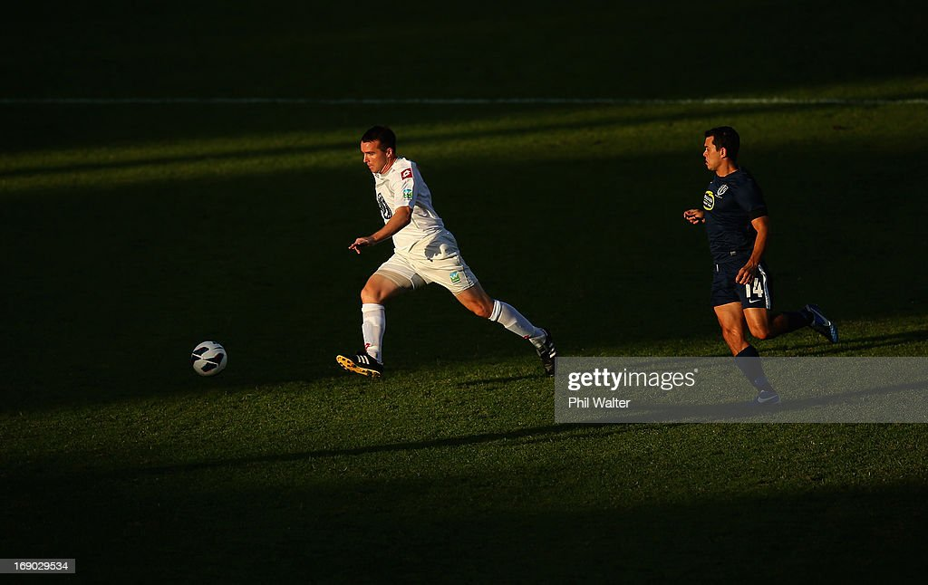 Brian Shelley of Waitakere takes the ball past Adam Dickinson of Auckland during the OFC Champions League Final match between Auckland and Waitakere at Mt Smart Stadium on May 19, 2013 in Auckland, New Zealand.