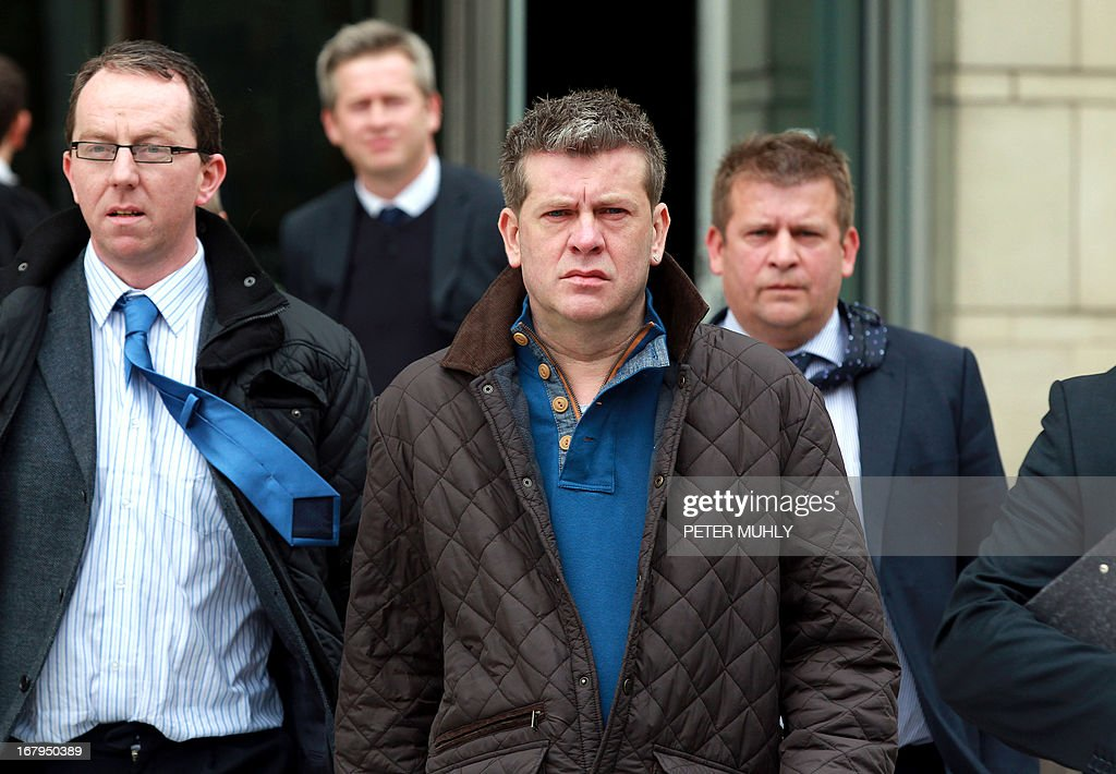 Brian Shivers (C) walks out of Belfast High Court with his legal team in Belfast, Northern Ireland on May 3, 2013 after he was acquitted in a retrial from the murder of two British soldiers. Last year, Shivers, 47, was convicted of the murders of Mark Quinsey, 23, and Patrick Azimkar, 21, and ordered to serve at least 25 years, but that judgement was quashed earlier this year by Northern Ireland's Court of Appeal.