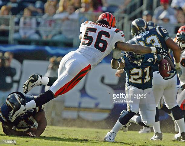 Brian Simmons of the Cincinnatti Bengals jumps to tackle LaDainian Tomlinson#21 of the San Diego Chargers in the 1st half during their NFL game on...
