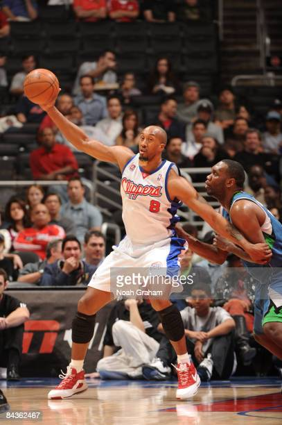 Brian Skinner of the Los Angeles Clippers holds the ball against Al Jefferson of the Minnesota Timberwolves at Staples Center January 19 2009 in Los...