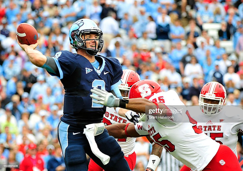 Brian Slay #55 of the North Carolina State Wolfpack pressures Bryn Renner #2 of the North Carolina Tar Heels during play at Kenan Stadium on October 27, 2012 in Chapel Hill, North Carolina.