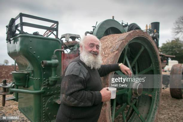 Brian Snegler poses for a photograph with his 1920 John Fowler steam ploughing engine at the 67th British National Ploughing Championships at...