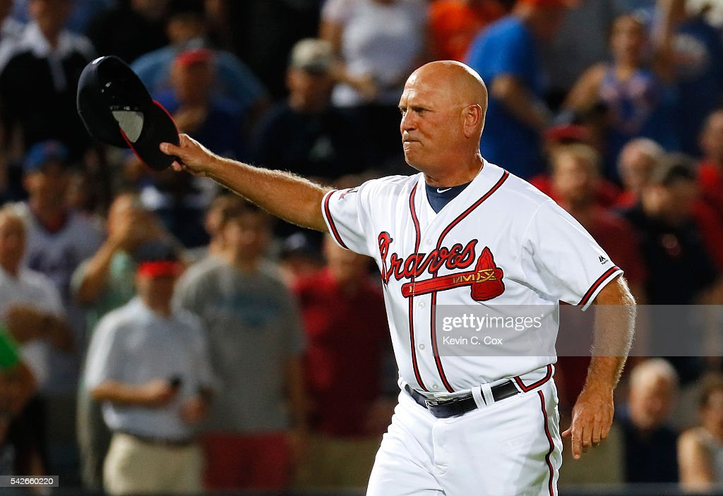 Brian Snitker of the Atlanta Braves reacts after being ejected by third base umpire Mike Everitt from arguing the call on the video review initiated...