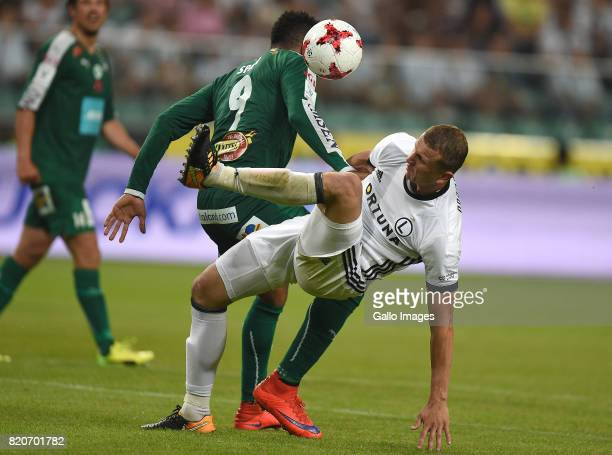 Brian Span of IFK Mariehamn Maciej Dabrowski of Legia Warszawa in action during the match between Legia Warszawa and IFK Mariehamn in the Champions...