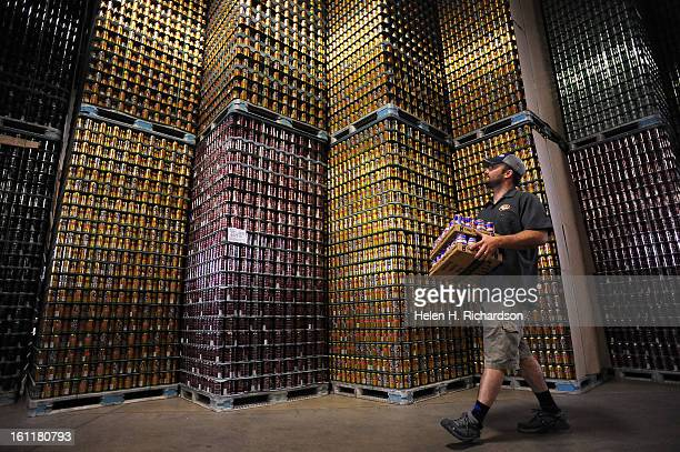 Brian Spotts shipping and receiving manager moves packaged beer past towers of empty cans waiting to be filledOskar Blues brewery located at 1800...