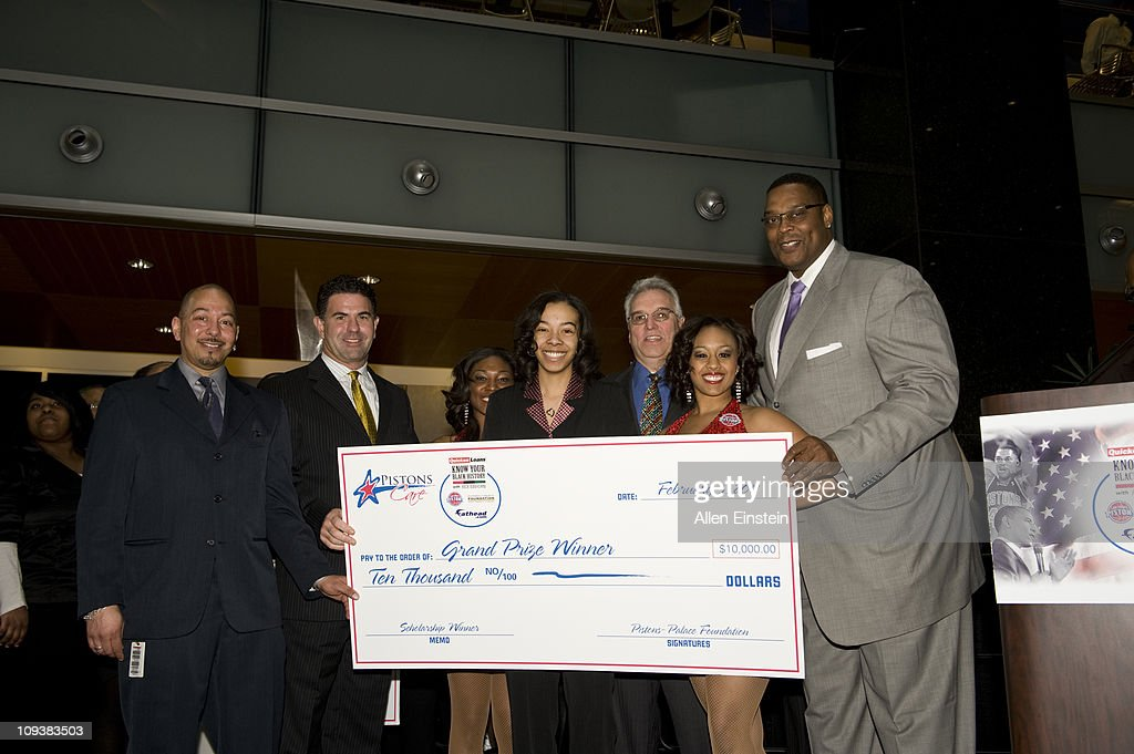 Brian Stevenson, Fathead Vice President, Patrick McInnis, Fathead CEO, Stephen Luigi Piazza, Quicken Loans Vice President, and Rick Mahorn, Detroit Piston legend, pose with Krystal Holmes after presenting the first place scholarship check during the Detroit Pistons, Quicken Loans, and Fathead Know Your Black History Event at the Compuware Building on February 23, 2011 in Detroit, Michigan.