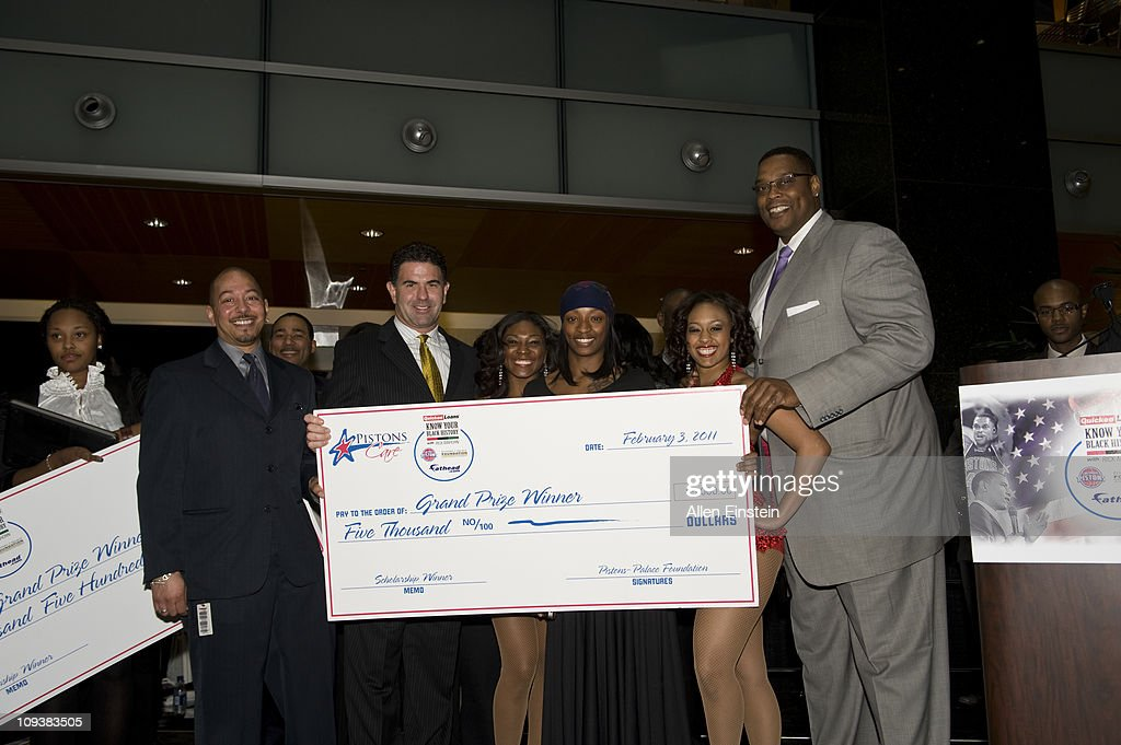 Brian Stevenson, Fathead Vice President, Patrick McInnis, Fathead CEO, and Rick Mahorn, Detroit Piston legend, pose with Shantell Williams after presenting the second place scholarship check during the Detroit Pistons, Quicken Loans, and Fathead Know Your Black History Event at the Compuware Building on February 23, 2011 in Detroit, Michigan.