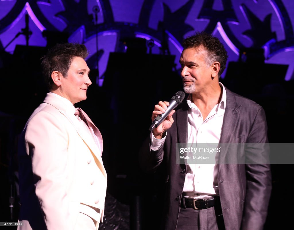 <a gi-track='captionPersonalityLinkClicked' href=/galleries/search?phrase=Brian+Stokes+Mitchell&family=editorial&specificpeople=213301 ng-click='$event.stopPropagation()'>Brian Stokes Mitchell</a> introduces <a gi-track='captionPersonalityLinkClicked' href=/galleries/search?phrase=k.d.+lang&family=editorial&specificpeople=583143 ng-click='$event.stopPropagation()'>k.d. lang</a> as she performs a special rare 'After Midnight' encore performance of her legendary rendition of the Leonard Cohen classic, 'Hallelujah' to raise money for the Actor's Fund at the Brooks Atkinson Theater on March 7, 2014 in New York City.