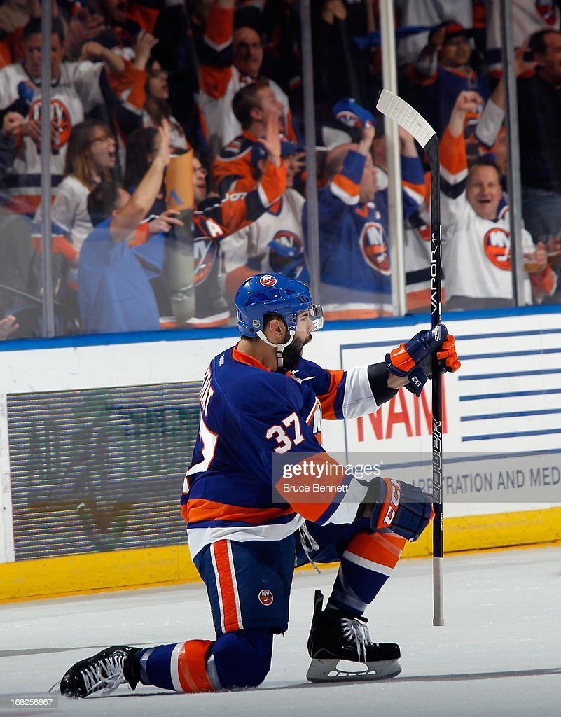 <a gi-track='captionPersonalityLinkClicked' href=/galleries/search?phrase=Brian+Strait&family=editorial&specificpeople=570466 ng-click='$event.stopPropagation()'>Brian Strait</a> #37 of the New York Islanders celebrates his goal at 14:05 of the first period against the Pittsburgh Penguins in Game Four of the Eastern Conference Quarterfinals during the 2013 NHL Stanley Cup Playoffs at the Nassau Veterans Memorial Coliseum on May 7, 2013 in Uniondale, New York.