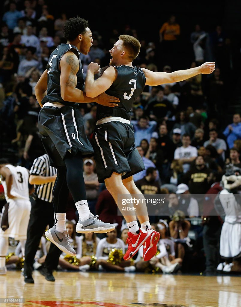 Brian Sullivan and Jordan Barham of the Davidson Wildcats celebrate an overtime victory against St Bonaventure Bonnies during the Quarterfinals of...