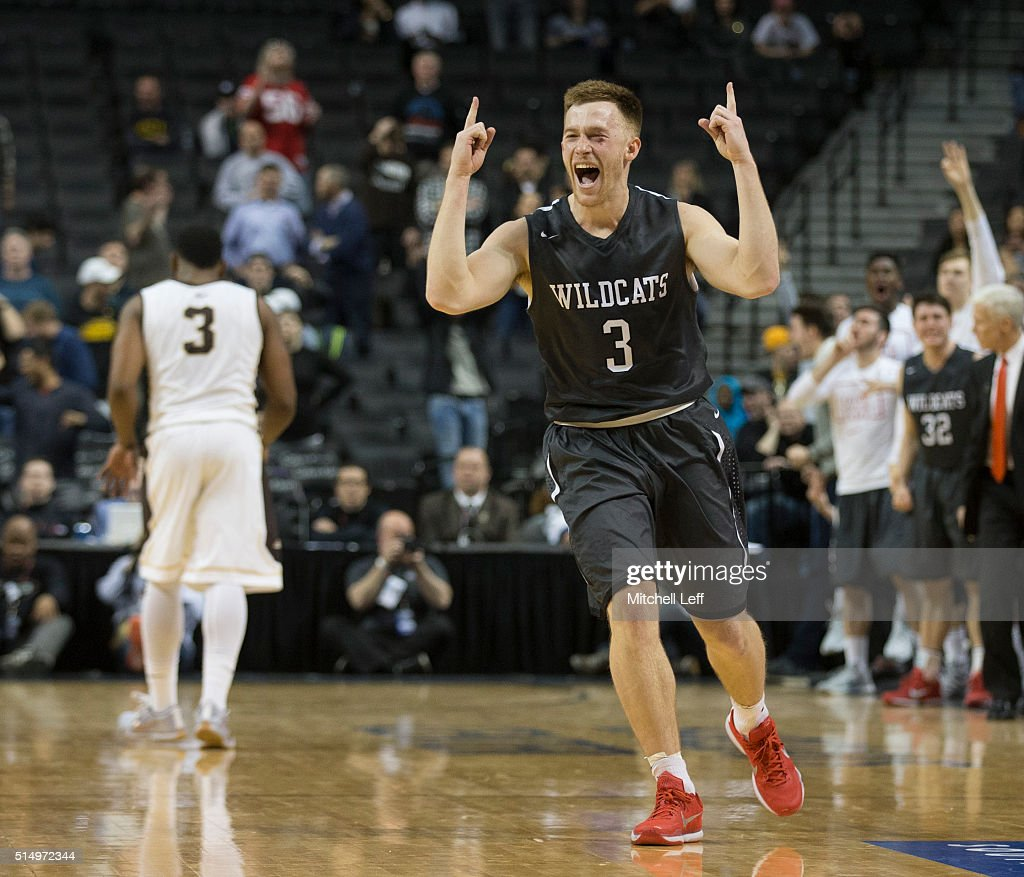 Brian Sullivan of the Davidson Wildcats reacts in front of Marcus Posley of the St Bonaventure Bonnies in the quarterfinals round of the men's...