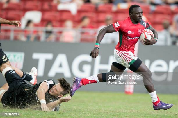 Brian Tanga of Kenya runs with the ball during the match New Zealand vs Kenya Day 2 of the HSBC Singapore Rugby Sevens as part of the World Rugby...
