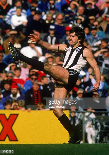 Brian Taylor of the Collingwood Magpies in action during a VFL held at the Melbourne Cricket Ground 1988 in Melbourne Australia