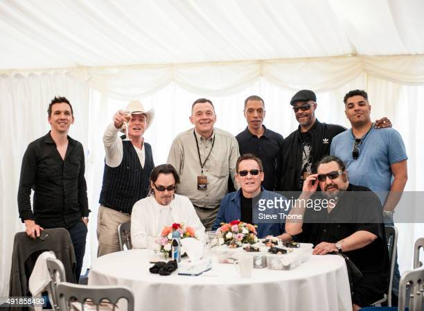 Brian Travers Duncan Campbell Robin Campbell Earl Falconer Norman Hassan and Jimmy Brown of UB40 pose backstage at Uttoxeter Racecourse on May 17...