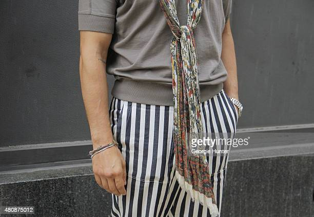 Brian Trunzo seen at Skylight Clarkson Sq outside the Greg Lauren show wearing Tomorrowland pants Tomas Maier top Drake's scarf and Omega watch...