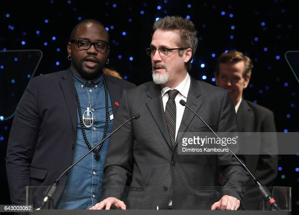 Brian Tyree Henry and Paul Simms speak onstage during 69th Writers Guild Awards New York Ceremony at Edison Ballroom on February 19 2017 in New York...