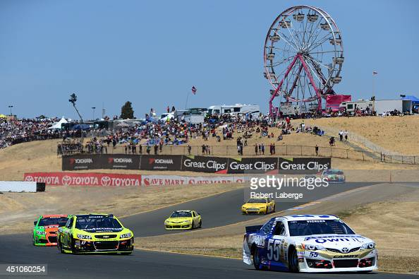 Brian Vickers driver of the Aaron's Dream Machine Toyota and Paul Menard driver of the Richmond / Menards Chevrolet lead a pack of cars during the...