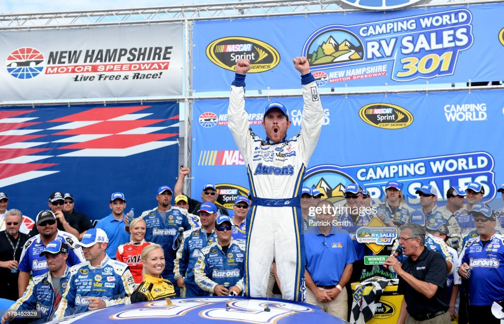 <a gi-track='captionPersonalityLinkClicked' href=/galleries/search?phrase=Brian+Vickers&family=editorial&specificpeople=171225 ng-click='$event.stopPropagation()'>Brian Vickers</a>, driver of the #55 Aaron's Dream Machine Toyota, celebrates in Victory Lane after winning the NASCAR Sprint Cup Series Camping World RV Sales 301 at New Hampshire Motor Speedway on July 14, 2013 in Loudon, New Hampshire.