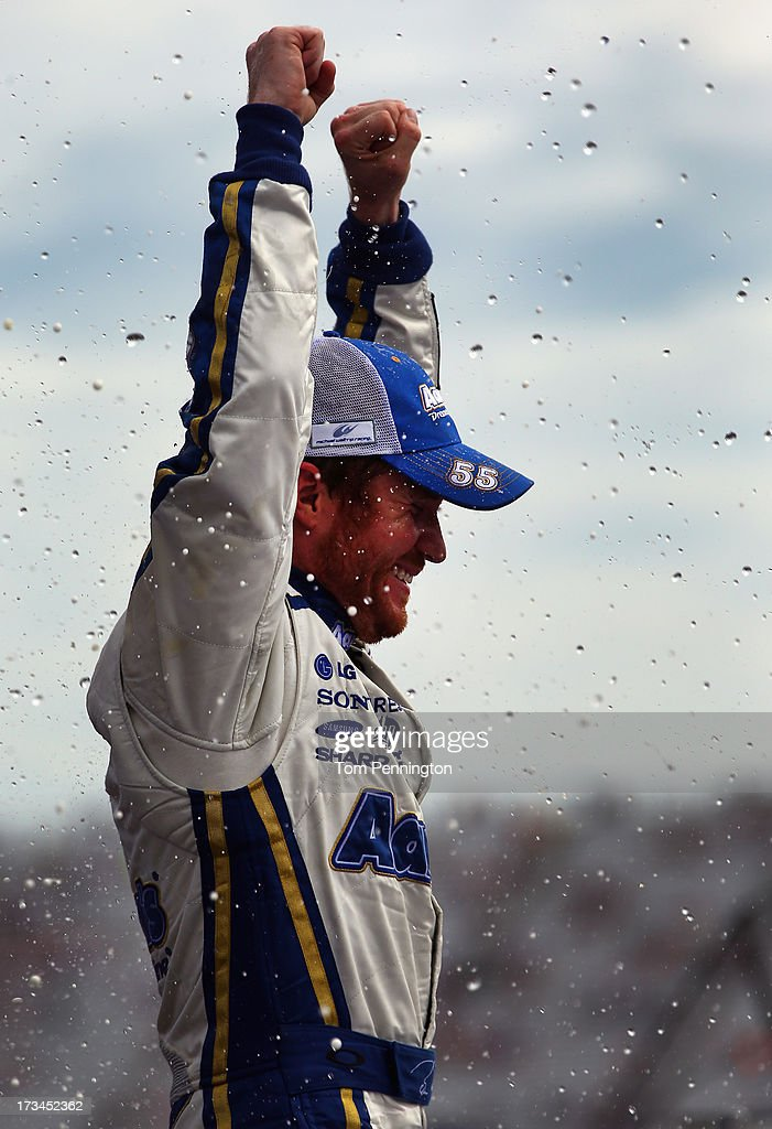 Brian Vickers, driver of the #55 Aaron's Dream Machine Toyota, celebrates in Victory Lane after winning the NASCAR Sprint Cup Series Camping World RV Sales 301 at New Hampshire Motor Speedway on July 14, 2013 in Loudon, New Hampshire.