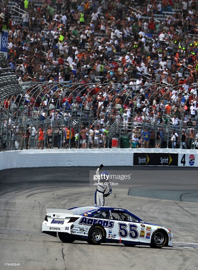 Brian Vickers, driver of the #55 Aaron's Dream Machine Toyota, celebrates winning the NASCAR Sprint Cup Series Camping World RV Sales 301 at New Hampshire Motor Speedway on July 14, 2013 in Loudon, New Hampshire.