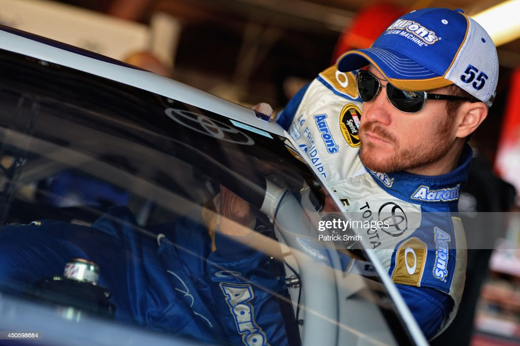 <a gi-track='captionPersonalityLinkClicked' href=/galleries/search?phrase=Brian+Vickers&family=editorial&specificpeople=171225 ng-click='$event.stopPropagation()'>Brian Vickers</a>, driver of the #55 Aaron's Dream Machine Toyota, climbs into his car during practice for the NASCAR Sprint Cup Series Quicken Loans 400 at Michigan International Speedway on June 14, 2014 in Brooklyn, Michigan.