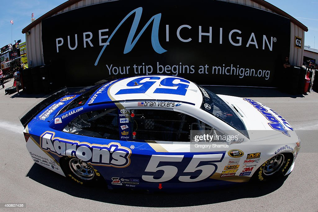 Brian Vickers, driver of the #55 Aaron's Dream Machine Toyota, drives through the garage area during practice for the NASCAR Sprint Cup Series Quicken Loans 400 at Michigan International Speedway on June 14, 2014 in Brooklyn, Michigan.