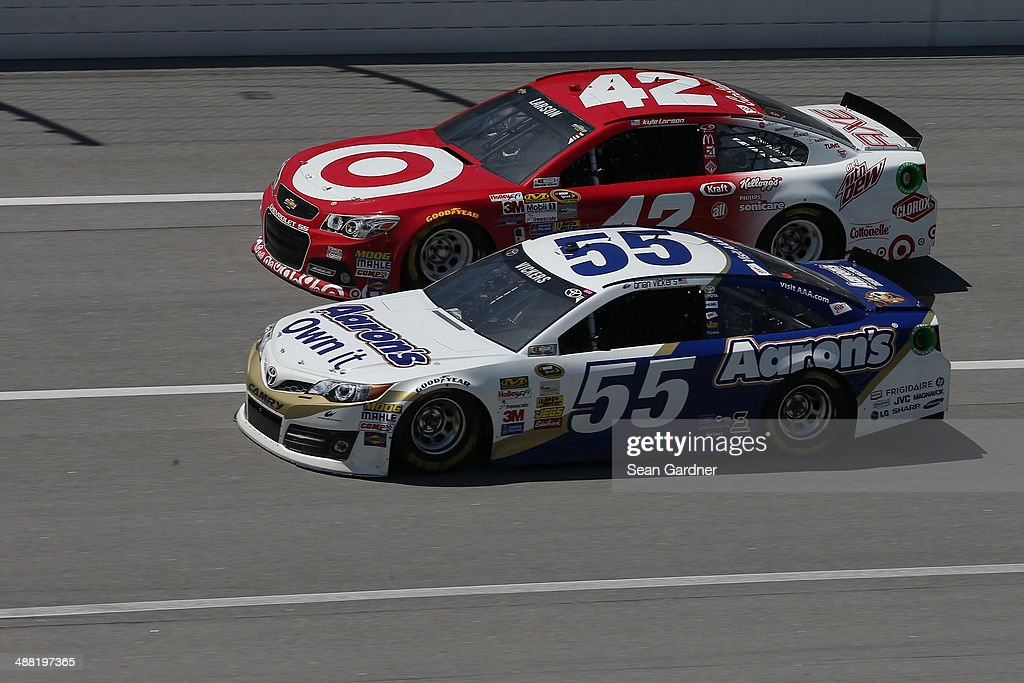 Brian Vickers, driver of the #55 Aaron's Dream Machine Toyota, leads Kyle Larson, driver of the #42 Target Chevrolet, during the NASCAR Sprint Cup Series Aaron's 499 at Talladega Superspeedway on May 4, 2014 in Talladega, Alabama.