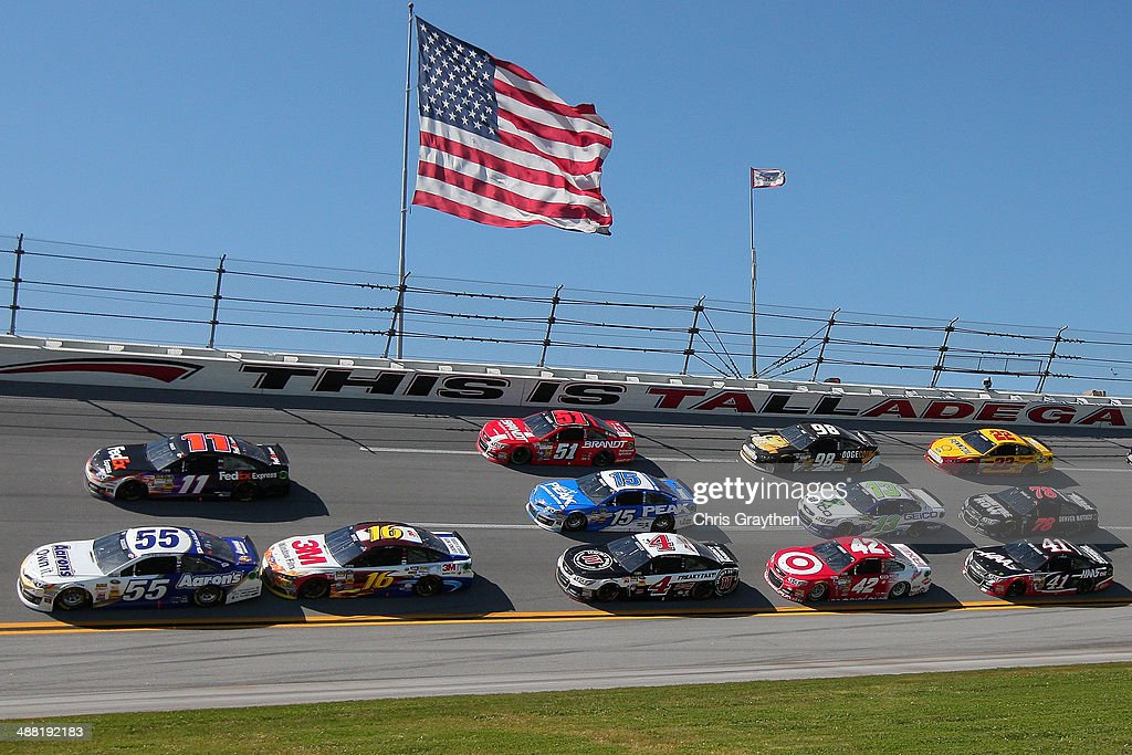 Brian Vickers, driver of the #55 Aaron's Dream Machine Toyota, leads the field during the NASCAR Sprint Cup Series Aaron's 499 at Talladega Superspeedway on May 4, 2014 in Talladega, Alabama.