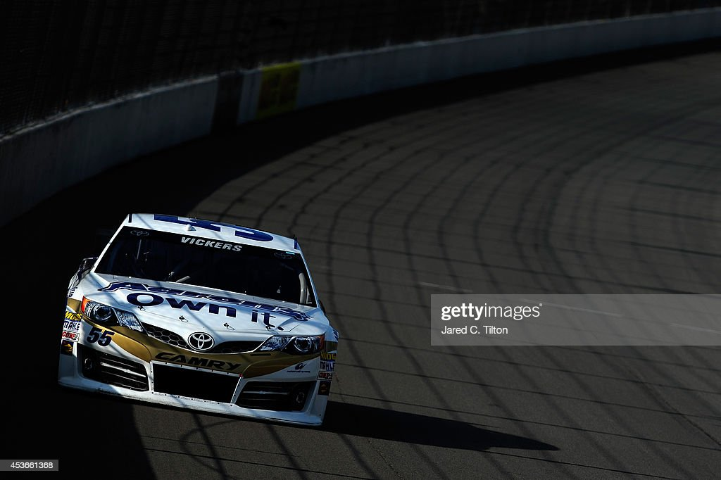 Brian Vickers, driver of the #55 Aaron's Dream Machine Toyota, qualifies for the NASCAR Sprint Cup Series Pure Michigan 400 at Michigan International Speedway on August 15, 2014 in Brooklyn, Michigan.
