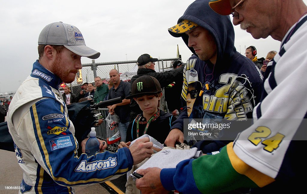 Brian Vickers, driver of the #55 Aaron's Dream Machine Toyota, signs autographs prior to the NASCAR Sprint Cup Series Geico 400 at Chicagoland Speedway on September 15, 2013 in Joliet, Illinois.