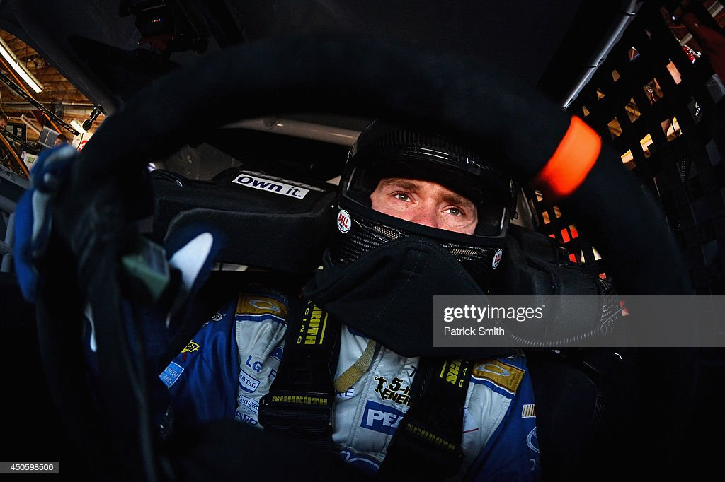 <a gi-track='captionPersonalityLinkClicked' href=/galleries/search?phrase=Brian+Vickers&family=editorial&specificpeople=171225 ng-click='$event.stopPropagation()'>Brian Vickers</a>, driver of the #55 Aaron's Dream Machine Toyota, sits in his car in the garage area during practice for the NASCAR Sprint Cup Series Quicken Loans 400 at Michigan International Speedway on June 14, 2014 in Brooklyn, Michigan.