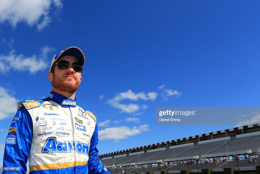 <a gi-track='captionPersonalityLinkClicked' href=/galleries/search?phrase=Brian+Vickers&family=editorial&specificpeople=171225 ng-click='$event.stopPropagation()'>Brian Vickers</a>, driver of the #55 Aaron's Dream Machine Toyota, walks down the grid during qualifying for the NASCAR Sprint Cup Series Pocono 400 at Pocono Raceway on June 6, 2014 in Long Pond, Pennsylvania.