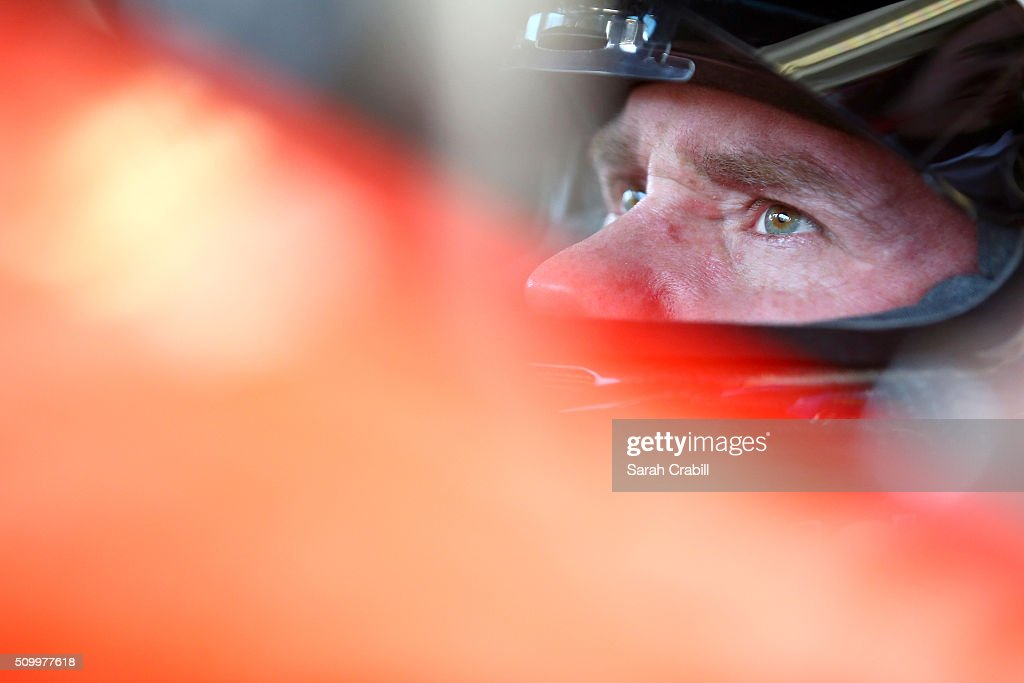 Brian Vickers, driver of the #14 Bass Pro Shops/Mobil 1 Chevrolet, sits in his car in the garage area during practice for the NASCAR Sprint Cup Series Daytona 500 at Daytona International Speedway on February 13, 2016 in Daytona Beach, Florida.