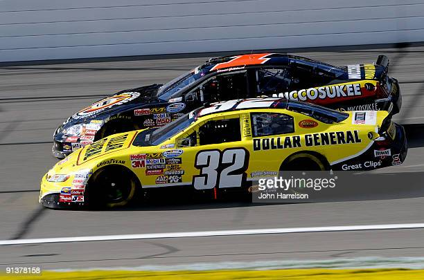 Brian Vickers driver of the Dollar General Stores Toyota races side by each against David Gilliland driver of the Miccosukee Indian Gaming Resort...