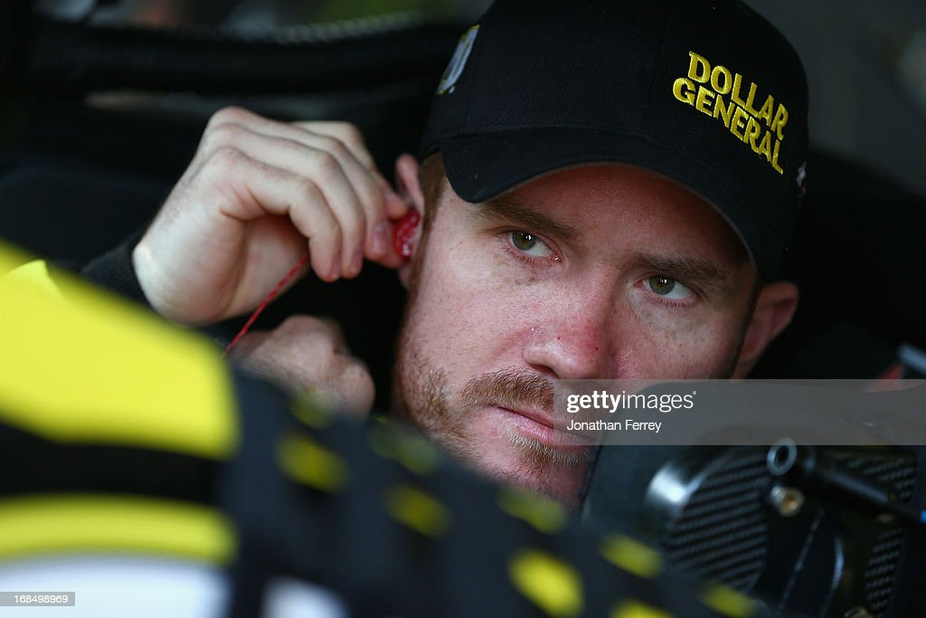 Brian Vickers, driver of the #20 Dollar General Toyota, adjusts his ear piece as he sits in his car during practice for the NASCAR Nationwide Series VFW Sport Clips Hero 200 at Darlington Raceway on May 10, 2013 in Darlington, South Carolina.