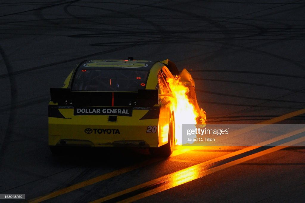 <a gi-track='captionPersonalityLinkClicked' href=/galleries/search?phrase=Brian+Vickers&family=editorial&specificpeople=171225 ng-click='$event.stopPropagation()'>Brian Vickers</a>, driver of the #20 Dollar General Toyota, has the side of his car flame up during the NASCAR Nationwide Series Aaron's 312 at Talladega Superspeedway on May 4, 2013 in Talladega, Alabama.