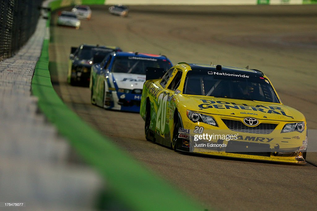 Brian Vickers, driver of the #20 Dollar General Toyota, leads a pack of cars during the NASCAR Nationwide Series U.S. Cellular 250 Presented by Enlist Weed Control System at Iowa Speedway on August 3, 2013 in Newton, Iowa.