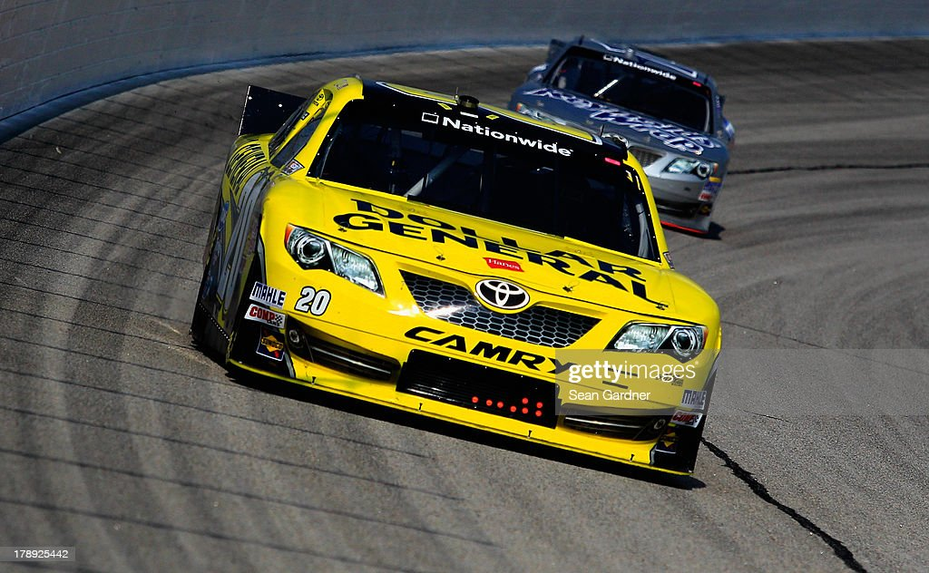 Brian Vickers, driver of the #20 Dollar General Toyota, leads Jeff Green, driver of the #14 Hefty / Reynolds Toyota, during practice for the NASCAR Nationwide Series Great Clips/Grit Chips 300 at Atlanta Motor Speedway on August 31, 2013 in Hampton, Georgia.