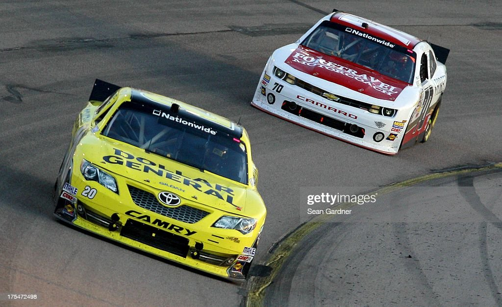 <a gi-track='captionPersonalityLinkClicked' href=/galleries/search?phrase=Brian+Vickers&family=editorial&specificpeople=171225 ng-click='$event.stopPropagation()'>Brian Vickers</a>, driver of the #20 Dollar General Toyota, leads Johanna Long, driver of the #70 ForeTravel Chevrolet, during the NASCAR Nationwide Series U.S. Cellular 250 Presented by Enlist Weed Control System at Iowa Speedway on August 3, 2013 in Newton, Iowa.