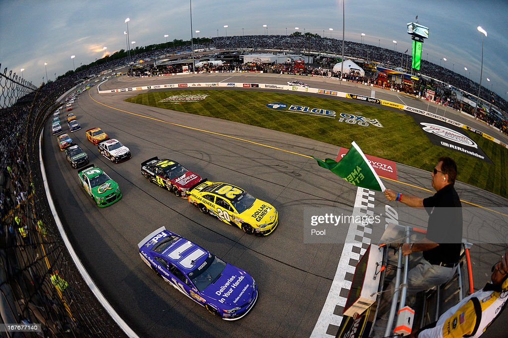 <a gi-track='captionPersonalityLinkClicked' href=/galleries/search?phrase=Brian+Vickers&family=editorial&specificpeople=171225 ng-click='$event.stopPropagation()'>Brian Vickers</a>, driver of the #11 FedEx Delivery Manager Toyota, and <a gi-track='captionPersonalityLinkClicked' href=/galleries/search?phrase=Matt+Kenseth&family=editorial&specificpeople=204192 ng-click='$event.stopPropagation()'>Matt Kenseth</a>, driver of the #20 Dollar General Toyota, lead the field to the green flag for the NASCAR Sprint Cup Series Toyota Owners 400 at Richmond International Raceway on April 27, 2013 in Richmond, Virginia.